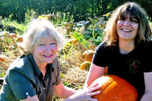 Kathy a volunteer and Cheryl who is one of our residents in the Rainbow Nursery pumpkin patch.